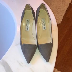 Sleek gray suede pumps with patent leather heel.